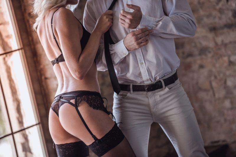 Blonde babe in stockings seducing business man
